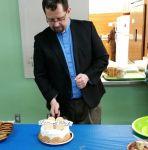 Patrick cutting cake